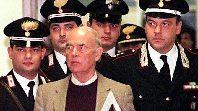 FILE - In this Thursday, Dec. 7, 1995 file photo, Former Nazi SS captain Erich Priebke enters the military court in Rome. Rome's mayor, police chief and the pope's right-hand man have all refused to grant Priebke a church funeral in the city where he participated in one of the worst massacres in German-occupied Italy. Now there's the added question of where to bury him, since Rome, his adopted homeland of Argentina, and his hometown in Germany won't take him. Priebke, who was sentenced to life in prison for his role in the 1944 massacre at the Ardeatine Caves, died Oct. 11, 2013 at age 100. (AP Photo/Domenico Stinellis, File)