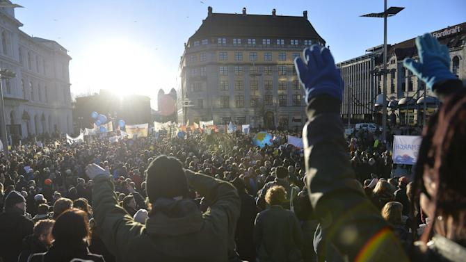 Participants take part in the Global Climate March, ahead of the 2015 Paris Climate Conference, known as the COP21 summit, in Oslo