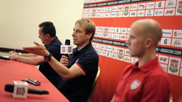 US coach Jurgen Klinsmann (C) speaks next to player Michael Bradley (R) (Reuters)