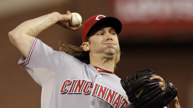 Cincinnati Reds starting pitcher Bronson Arroyo (61) delivers in the first inning during Game 2 of the National League division baseball series against the San Francisco Giants in San Francisco, Sunday, Oct. 7, 2012. (AP Photo/Marcio Jose Sanchez)
