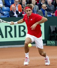 Swiss tennis player Roger Federer hits a return to Netherlands' Thiemo de Bakker during their Davis Cup world group play-off match in Amsterdam. Federer won 6-3, 6-4, 6-4