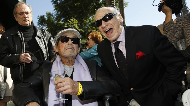 Actor Mazursky holds a martini as he poses with producer Brooks at the ceremony for the unveiling of his star on the Walk of Fame in Hollywood