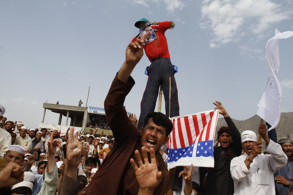 Afghans shout anti-American slogans in Ghanikhel district of Nangarhar province, east of Kabul, Afghanistan, Friday, Sept. 14, 2012 during a protest against an anti-Islam film which depicts the Prophet Muhammad as a fraud, a womanizer and a madman. (AP Photo/Rahmat Gul)