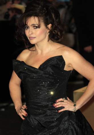 FILE - In this Wednesday, Dec. 5, 2012 file photo, Helena Bonham Carter arrives on the red carpet for the World Premiere of &quot;Les Miserables&quot; at a central London cinema in Leicester Square. A report from Ancestry.com says Victor Hugo was a political colleague of a cousin of the 46-year-old actress. Carter stars as Madame Thenardier in the upcoming musical “Les Miserables.” (Photo by Joel Ryan/Invision/AP, File)