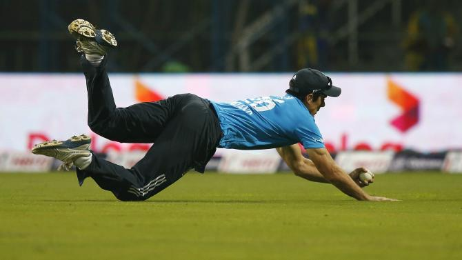 England's captain Cook dives to take the catch to dismiss Sri Lanka's Perera during their first ODI cricket match in Colombo