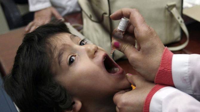 A Syrian child is given a polio vaccination at a clinic in Damascus on November 20, 2013