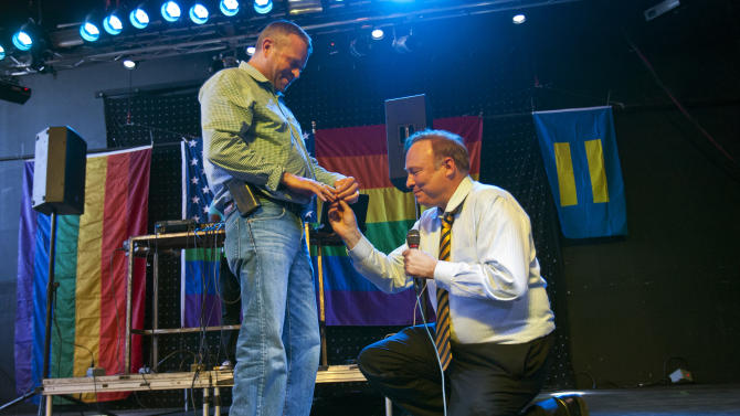 Utah Sen. Jim Dabakis, D-Salt Lake City, proposes to Stephen Justesen, his boyfriend of over twenty-five years, during a party at Club Sound Wednesday June 26, 2013 in Salt Lake City. Dabakis said the proposal was a spur-of-the-moment decision and a wedding date has not been set. In historic decisions, the U.S. Supreme Court handed gay-rights supporters major victories Wednesday, extending federal rights to same-sex couples and reversing a ban on gay marriage in California. (AP Photo/The Salt Lake Tribune, Chris Detrick)