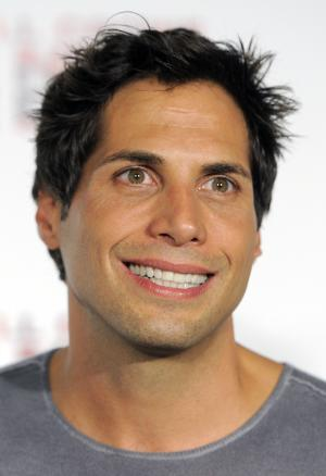 "FILE - In this Nov. 16, 2010 file photo, Joe Francis, producer of the ""Girls Gone Wild"" videos, arrives at a screening of the film ""The Next Three Days,"" in Los Angeles. Francis and his bodyguard surrendered Monday, Aug. 22, 2011, on charges stemming from a January altercation with three women, who authorities claim Francis tried to prevent from leaving his home. (AP Photo/Chris Pizzello, file)"