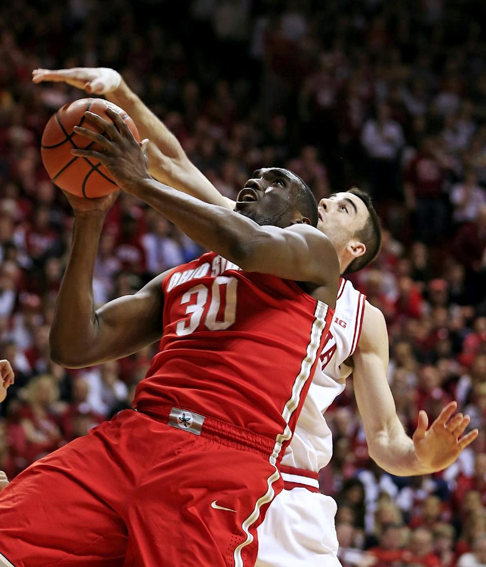Ohio State's Evan Ravenel (30) has his shot blocked by Indiana's Will Sheehey during the first half of an NCAA college basketball game, Tuesday, March 5, 2013, in Bloomington, Ind. (AP Photo/Darron Cummings)