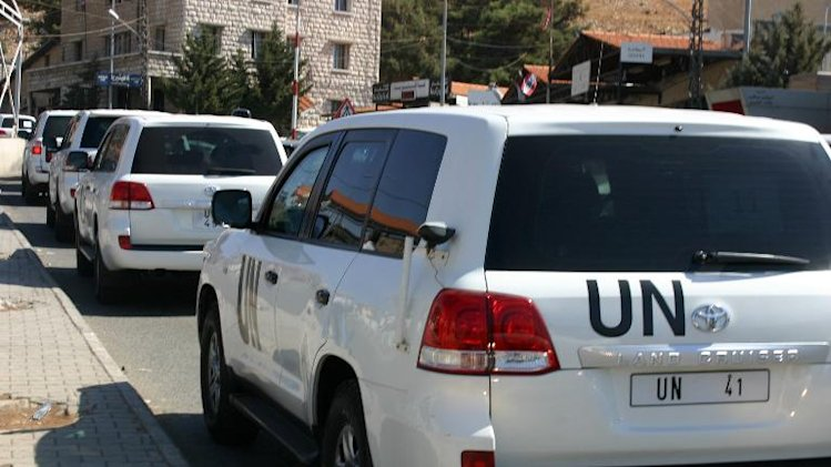 A convoy of United Nations vehicles is seen at the Lebanon-Syria Masnaa border crossing on October 1, 2013 as a chemical weapons disarmament team cross into Syria