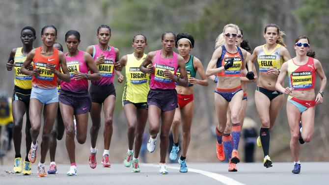 Elite female marathoners, front row from left, Rita Jeptoo, Mamitu Daska, Meserat Debele, Tirifi Beyene, Alemitu Begna, Shalane Flanagan, Ana Felix and Sabrina Mockenhaupt compete on the course in Wellesley, Mass., Monday, April 15, 2013. (AP Photo/Michael Dwyer)