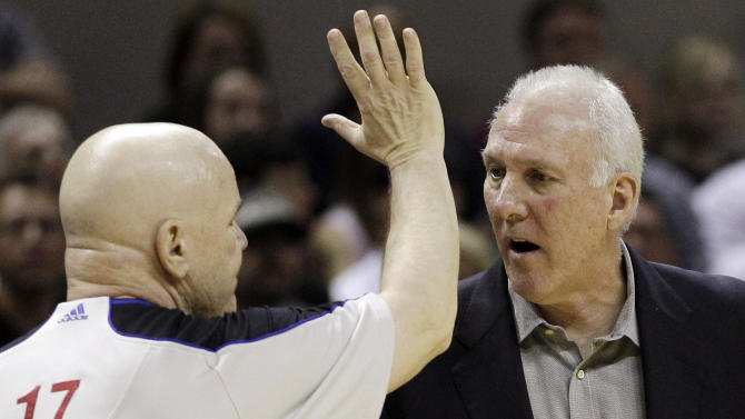 San Antonio Spurs head coach Gregg Popovich, right, discusses a play with referee Joe Crawford (17) during the first half of Game 1 in their NBA basketball Western Conference finals playoff series, Sunday, May 27, 2012, in San Antonio. (AP Photo/Eric Gay)