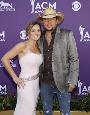 Jason Aldean, left, and Jessica Aldean arrive at the 47th Annual Academy of Country Music Awards on Sunday, April 1, 2012 in Las Vegas. (AP Photo/Isaac Brekken)