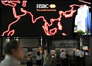 File photo shows people using ATM machines at the HSBC headquarters in Hong Kong. In early November HSBC said it had set aside $1.5 billion for fines linked to money-laundering in the United States