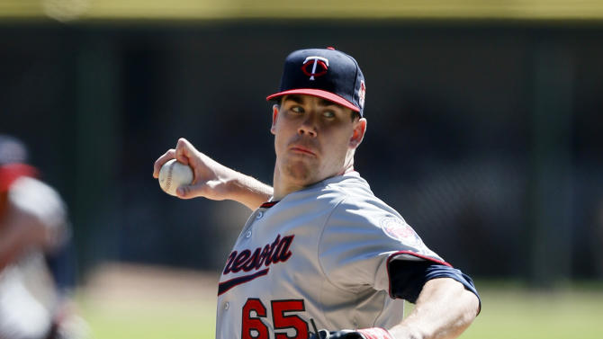Rookie May fans 10 as Twins beat White Sox 6-4