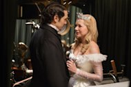 This film image released by Disney Enterprises shows James Franco, left, and Michelle Williams in a scene from &quot;Oz the Great and Powerful.&quot; (AP Photo/Disney Enterprises, Merie Weismiller Wallace)