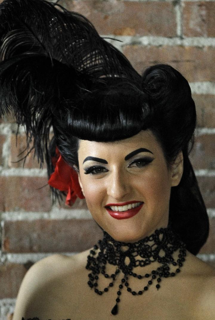 "In this March 5, 2012, photo, a model who goes by the name of ""Vita Devoid"" poses for a photo before an internet pinup show at an Ybor City studio in Tampa, Fla. (AP Photo/Chris O'Meara)"