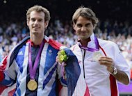 Andy Murray (left) and Roger Federer with their gold and silver medals after Murray beat the Swiss star in the Olympic final. Murray may have captured the US Open and Olympic titles, but he insisted Tuesday that Roger Federer and vanquished New York rival Novak Djokovic remain the standout players of 2012