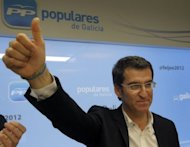 A Popular Party candidate for the regional elections in Galicia, Alberto Nunez Feijoo celebrates exit poll results after regional elections in Santiago de Compostela, northwestern Spain. Spanish Prime Minister Mariano Rajoy&#39;s right-leaning party on Sunday retained power in his home region of Galicia despite recession and biting austerity measures, official results showed