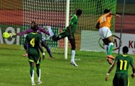 Ivory Coast's Didier Drogba (Top R) shoots against Senegal during the African Cup of Nations qualification match at the Felix Houphouet-Boigny stadium in Abidjan. Ivory Coast won 4-2