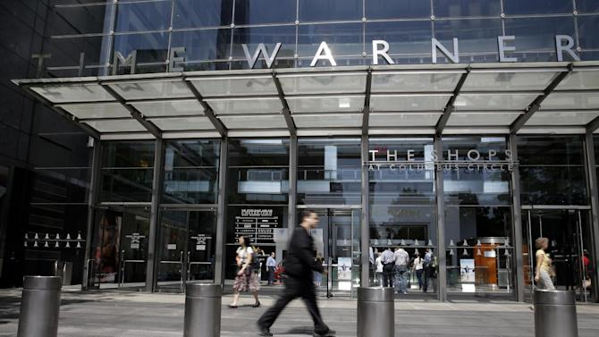 Pedestrians walk past the Time Warner Center, home of the headquarters of Time Warner Cable, Tuesday, May 26, 2015, in New York. Charter Communications will spend $55.33 billion to acquire Time Warner Cable in a cash-and-stock deal that would instantly create one of the largest pay-television and broadband operators in the U.S. (AP Photo/Mary Altaffer)