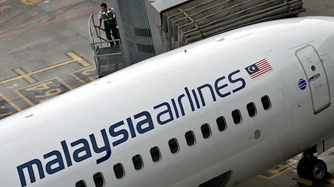 A Malaysia Airlines plane is seen shortly prior its departure from Kuala Lumpur International Airport, in Sepang, on May 14, 2014