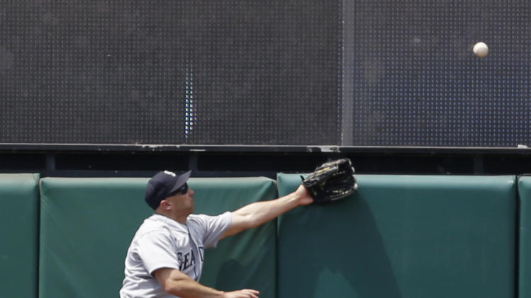 Seattle Mariners' Raul Ibanez jumps but cannot get to a ball hit by Cleveland Indians' Jason Kipnis in the fourth inning of a baseball game on Sunday, May 19, 2013, in Cleveland. Kipnis was safe for a double. (AP Photo/Tony Dejak)
