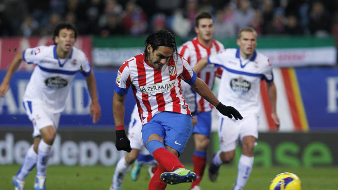 Atletico de Madrid's Radamel Falcao from Colombia, from, scores his goal during a Spanish La Liga soccer match against Deportivo la Coruna at the Vicente Calderon stadium in Madrid, Spain, Sunday, Dec. 9, 2012. (AP Photo/Andres Kudacki)