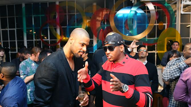 "NBA Basketball players Tyson Chandler, left, and Carmelo Anthony are seen at Chandler's art gallery debut, ""A Year in New York Minute"", on Wednesday, Sept. 26, 2012 in New York. (John Minchillo/AP Images)"