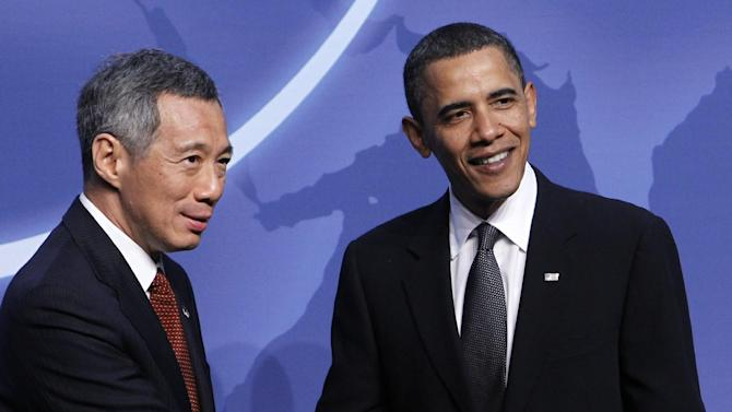 FILE - In this April 12, 2010 file photo, President Barack Obama shakes hands with Singapore's Prime Minister Lee Hsien Loong in Washington. On Tuesday, Prime Minister Loong becomes the third Asian leader to visit the White House his yeas as President Barack Obama looks to strengthen ties with Asia in his second term.  (AP Photo/Charles Dharapak, File)