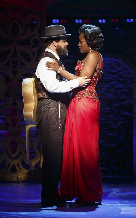 "This theater image released by Richard Kornberg & Associates shows Eric Anderson, left, and Amber Iman during a performance of the Broadway musical ""Soul Doctor."" (AP Photo/Richard Kornberg & Associates, Carol Rosegg)"