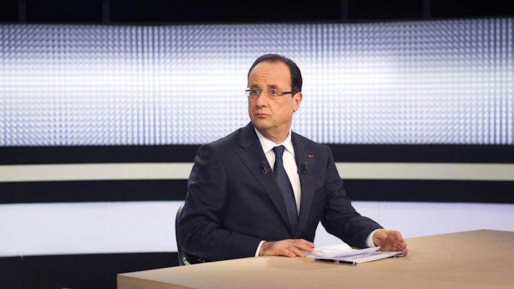 France President Francois Hollande takes part in a televised interview on a French TV channel, Thursday, March 28, 2013, in Paris, France. (AP Photo/ Fred Dufour-Pool)