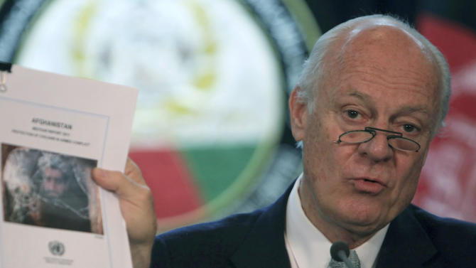 Special UN representative for Afghanistan Staffan de Mistura holds a copy of the report on the protection of civilians in armed conflict during a press conference in Kabul, Afghanistan, Thursday, July 14, 2011.The U.N. says the number of Afghan civilians killed in bombings and other attacks is up 15 percent from the same period last year.(AP Photo/Rafiq Maqbool)