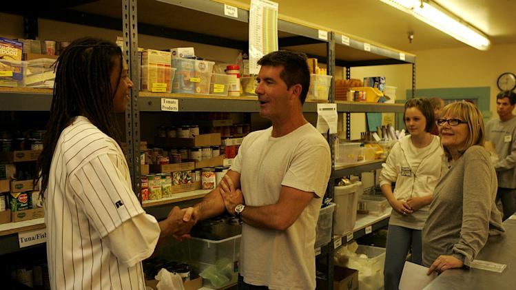 Simon Cowell helps distribute food at the Los Angeles Food Bank, as featured on Idol Gives Back.