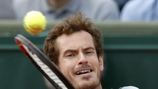 Andy Murray of Britain plays a shot to Nick Kyrgios of Australia during their men's singles match at the French Open tennis tournament at the Roland Garros stadium in Paris