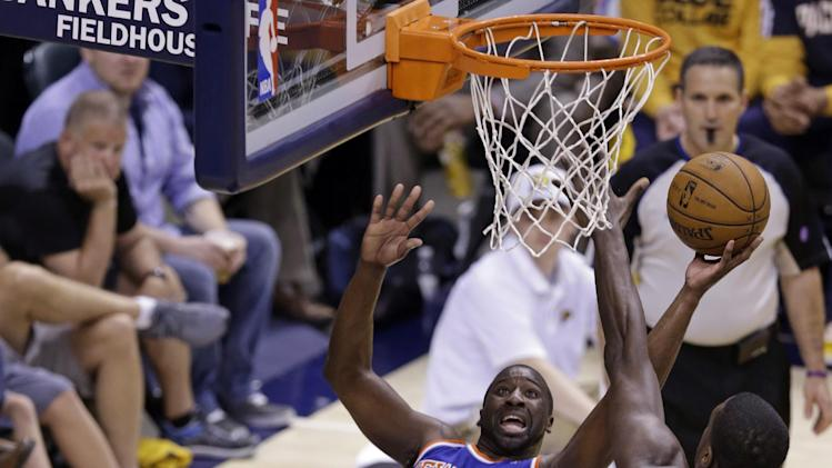 New York Knicks guard Raymond Felton hits a shot and is fouled by Indiana Pacers center Roy Hibbert during the second half of Game 4 of the Eastern Conference semifinal NBA basketball playoff series, in Indianapolis on Tuesday, May 14, 2013. (AP Photo/Michael Conroy)