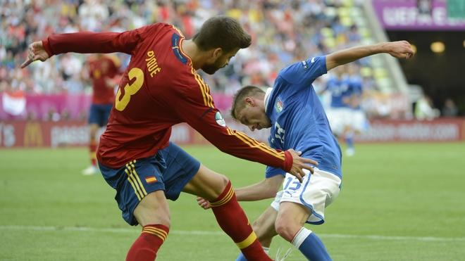 Spanish Defender Gerard Pique (L) Fights AFP/Getty Images