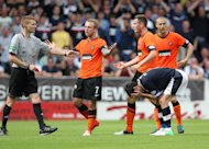 Peter Houston hopes Johnny Russell's, right, red card will be rescinded
