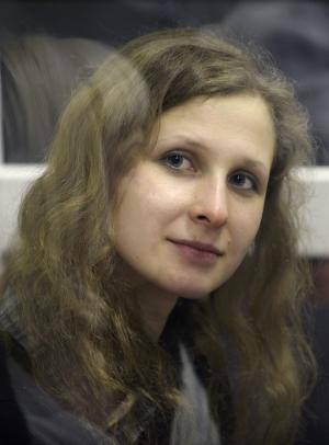 File - File photo dated Wednesday, Jan. 16, 2013 of jailed feminist punk band Pussy Riot member Maria Alekhina in a defendant's cage in a court room in the town of Berezniki, some 1500 km (940 miles) north-east of Moscow, Russia. A jailed member of the Russian punk group Pussy Riot was hospitalized Tuesday May 28, 2013, on the seventh day of a hunger strike to protest what she calls a persecution campaign against her. Alekhina was convicted last year along with two other band members of hooliganism motivated by religious hatred for an anti-President Vladimir Putin stunt in Russia's main cathedral. (AP Photo/Alexander Agafonov, File)