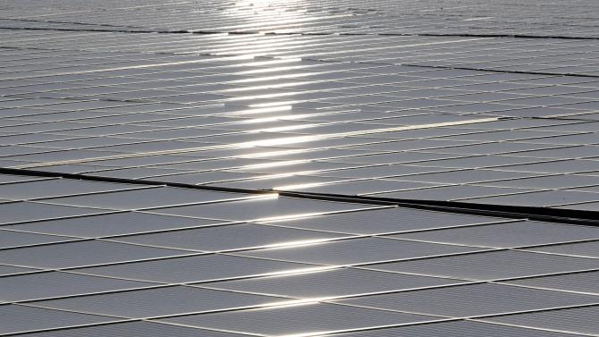 A general view shows solar panels used to produce renewable energy at the photovoltaic park during its official inauguration in Cestas, southwestern France