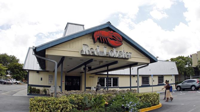 FILE - In this Thursday, Sept. 6, 2012 file photo, a Red Lobster restaurant is shown in Hialeah, Fla. The chain that brought seafood to the masses is hoping to broaden its appeal by revamping its menu on Oct. 15 to boost the number of dishes that cater to diners who don't want seafood, including lighter options such as salads. Red Lobster also is increasing the number of dishes that cost less than $15 to attract customers who have cut back on spending (AP Photo/Alan Diaz, File)