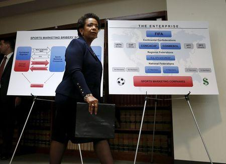 U.S. Attorney General Loretta Lynch walks by display panels during a news conference at the U.S. Attorney's Office of the Eastern District of New York in the Brooklyn borough of New York