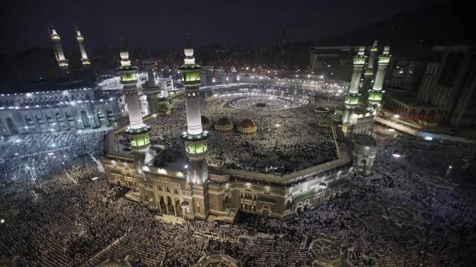 Muslim pilgrims pray at the Grand Mosque in the holy city of Mecca