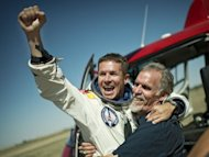 Felix Baumgartner of Austria and technical project director Art Thompson of the Unites States celebrate in Roswell, New Mexico, after Baumgartner's successful jump from the edge of space in this photo provided by www.redbullcontentpool.com. Baumgartner became the first man to break the sound barrier in a record-shattering, death-defying freefall jump