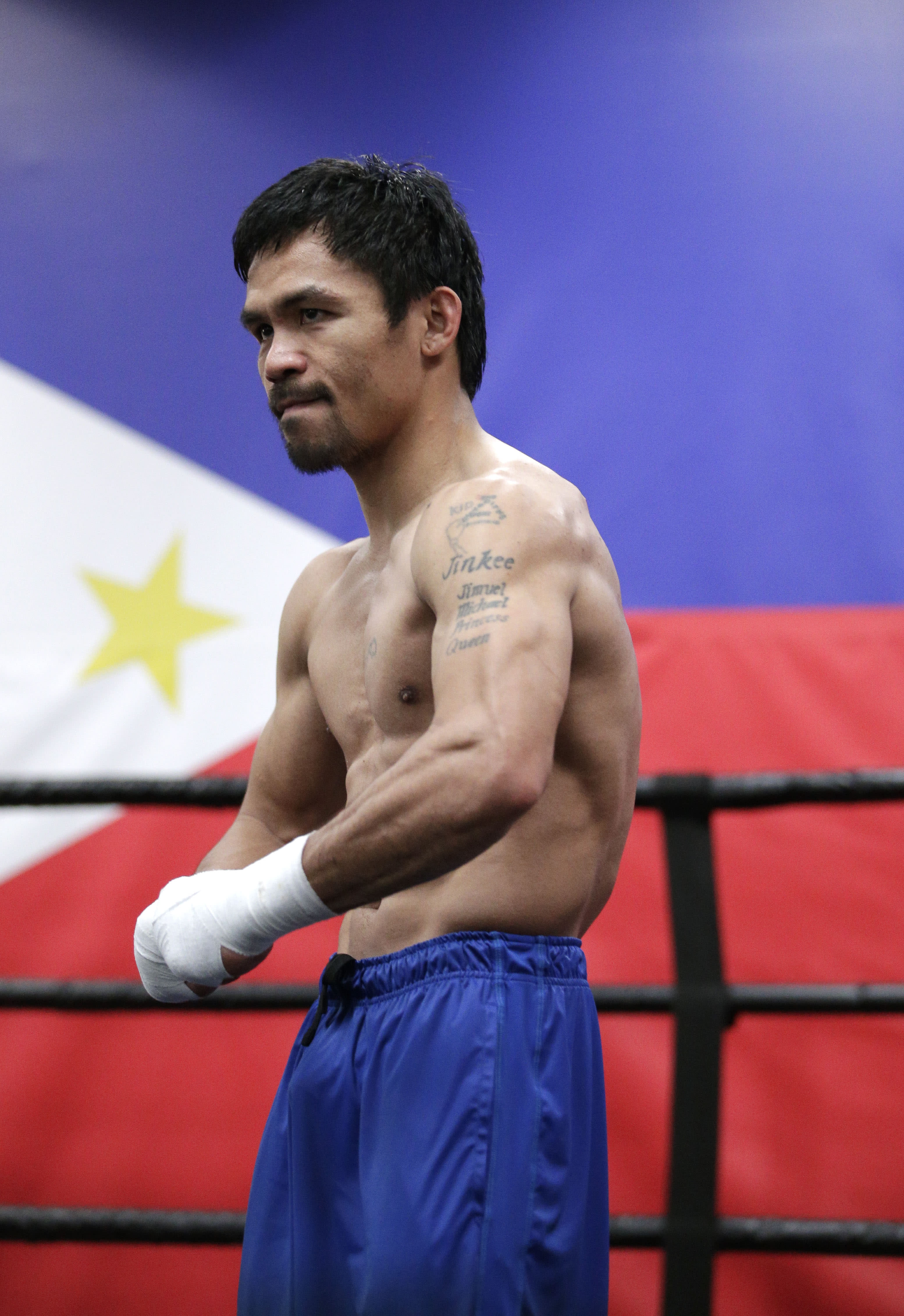 Pacquiao, Roach scheme on plan for Mayweather's defense