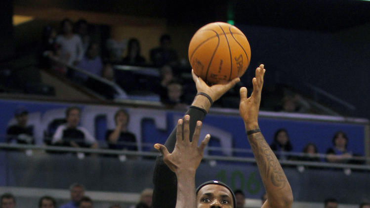 Miami Heat forward LeBron James (6) shoots over Orlando Magic guard Jason Richardson (23) during the first half of an NBA preseason basketball game, Wednesday, Dec. 21, 2011, in Orlando, Fla. (AP Photo/Reinhold Matay)