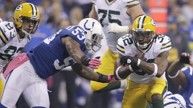 Green Bay Packers running back Cedric Benson is tackled by Indianapolis Colts inside linebacker Kavell Conner (53) during the first half of an NFL football game in Indianapolis, Sunday, Oct. 7, 2012. (AP Photo/Michael Conroy)