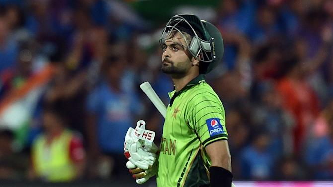 Pakistan's Ahmed Shehzad walks off the field following dismissal during their Cricket World Cup Pool B match against India, at the Adelaide Oval, on February 15, 2015