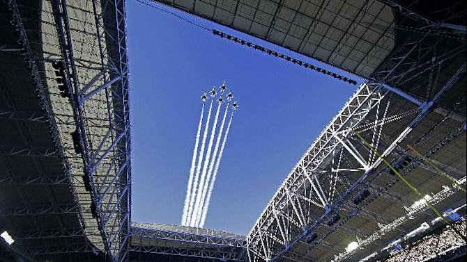 Planes fly over University of Phoenix Stadium as singer Idina Menzel performs the national anthem before the NFL Super Bowl XLIX football game between the Seattle Seahawks and the New England Patriots on Sunday, Feb. 1, 2015, in Glendale, Ariz. (AP Photo/Matt Rourke)