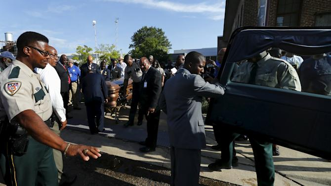 Blues legend B.B. King's casket is moved to a waiting hearse as it leaves the B.B. King museum following a day of public viewing in Indianola, Mississippi